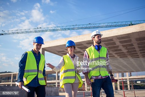 Architect and builders talking on site