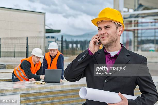 Architect and construction team