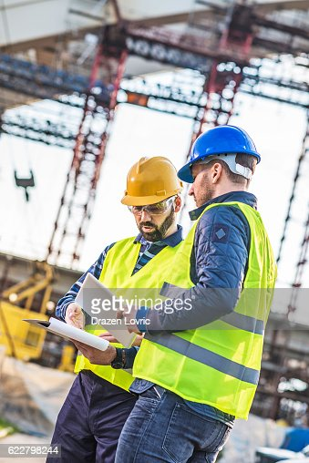 Architect and contractor discussing bridge building project