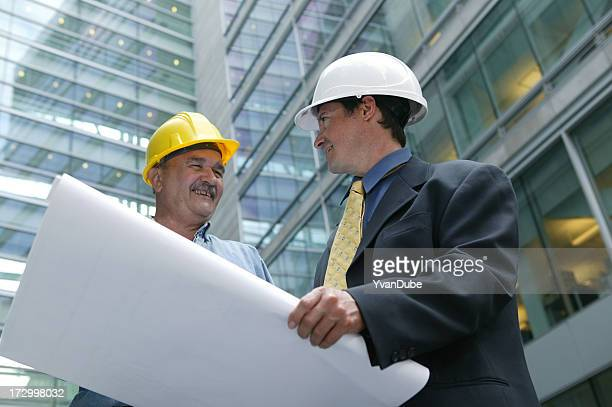 architect and foreman in front of a building site