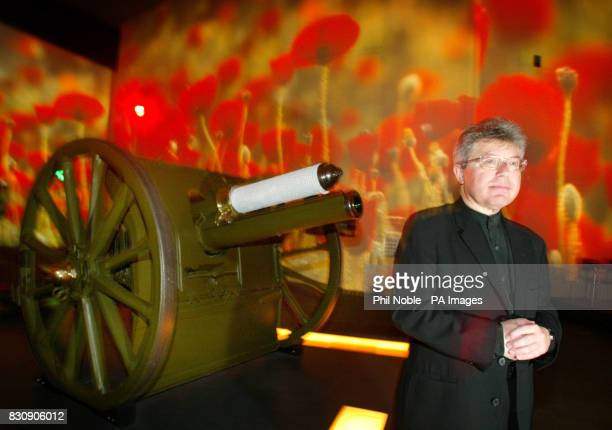Architect Daniel Libeskind stands in front of a First World War field gun and a projected field of poppies inside the Imperial War Museum North in...