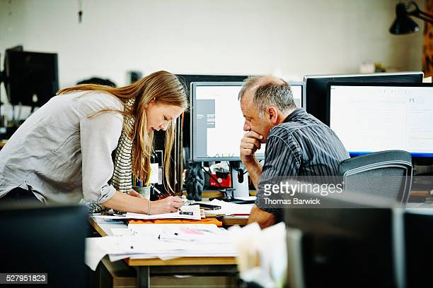 Architect discussing project with coworker
