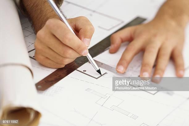 Architect editing blueprint, close-up