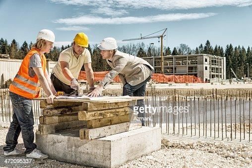 Architect explaining blueprints