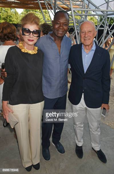 Architect Francis Kere poses with Lady Elena Ochoa Foster and Lord Norman Foster at a preopening drinks reception celebrating the 2017 Serpentine...