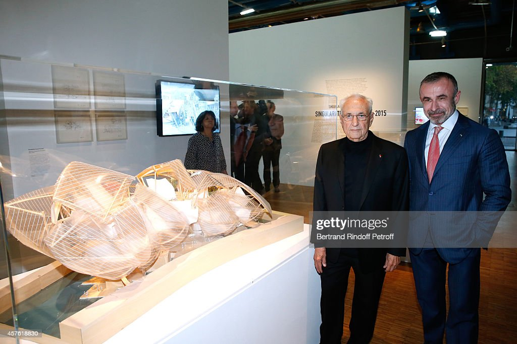 Architect Franck Gehry and President of Centre Pompidou <a gi-track='captionPersonalityLinkClicked' href=/galleries/search?phrase=Alain+Seban&family=editorial&specificpeople=4515859 ng-click='$event.stopPropagation()'>Alain Seban</a> pose front of the model of the Louis Vuitton Foundation attending the 'Frank Gehry' : Exhibition in the presence of Frank Gehry who was elevated to the rank of Commander of the Legion of Honor this morning by the President of the French republic. Held at Centre Pompidou on October 21, 2014 in Paris, France.