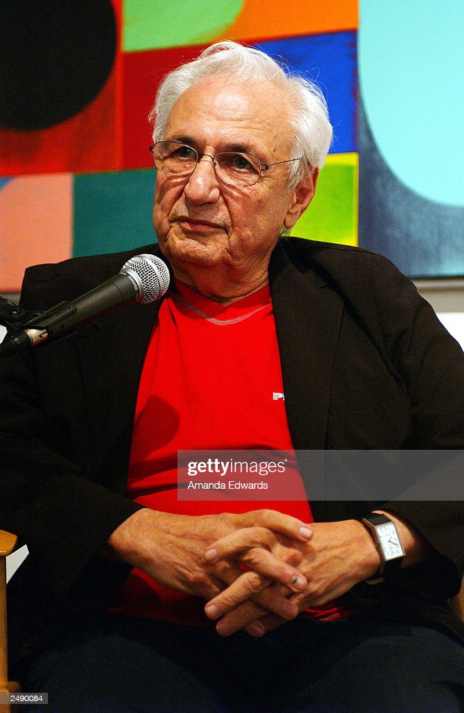 Architect Frank Gehry answers questions at the Santa Monica Museum of Art's Party with Frank Gehry at Chuck Arnoldi's art studio on September 12, 2003 in Venice, California.