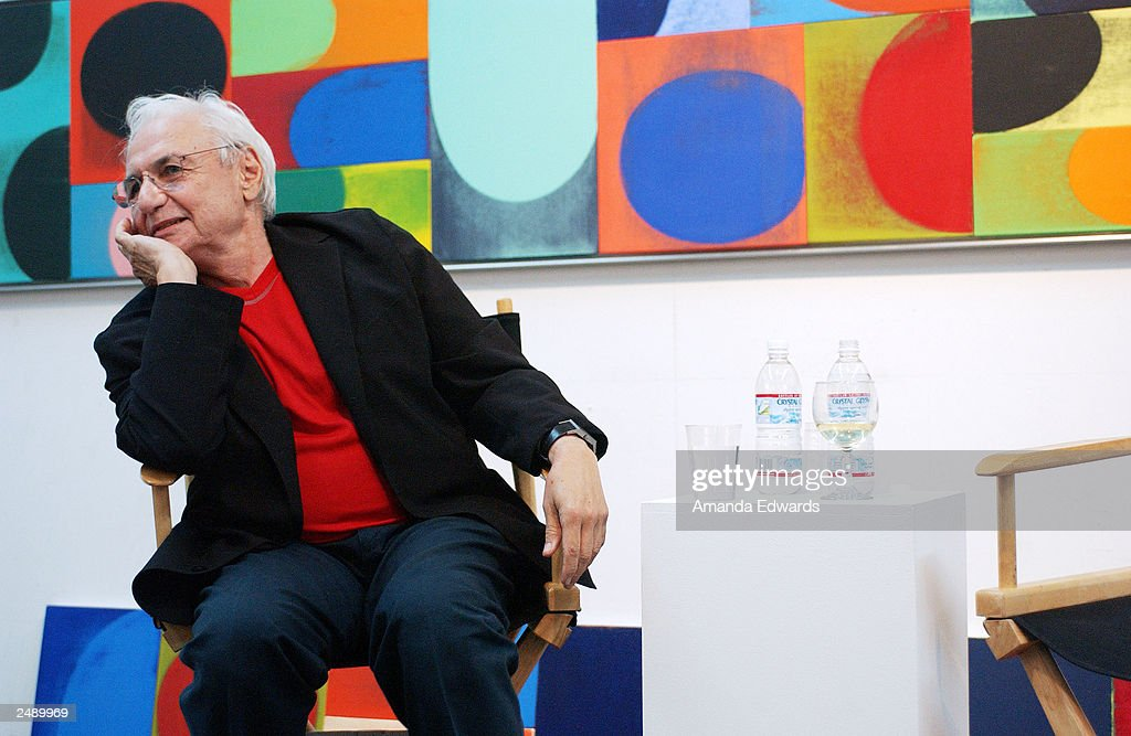 Architect Frank Gehry answers questions during the Santa Monica Museum of Art's Party with Frank Gehry at Chuck Arnoldi's art studio on September 12, 2003 in Venice, California.