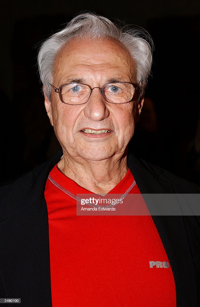 Architect Frank Gehry poses at the Santa Monica Museum of Art's Party with Frank Gehry at Chuck Arnoldi's art studio on September 12, 2003 in Venice, California.