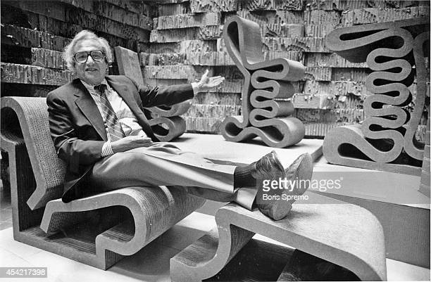 Architect Frank Gehry sits on one of his cardboard chairs photo taken by Boris Spremo/Toronto Star Aug 28 1987
