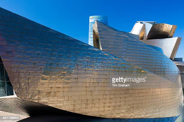 Architect Frank Gehry's Guggenheim Museum futuristic design in titanium and glass and Iberdrola Tower behind at Bilbao Spain