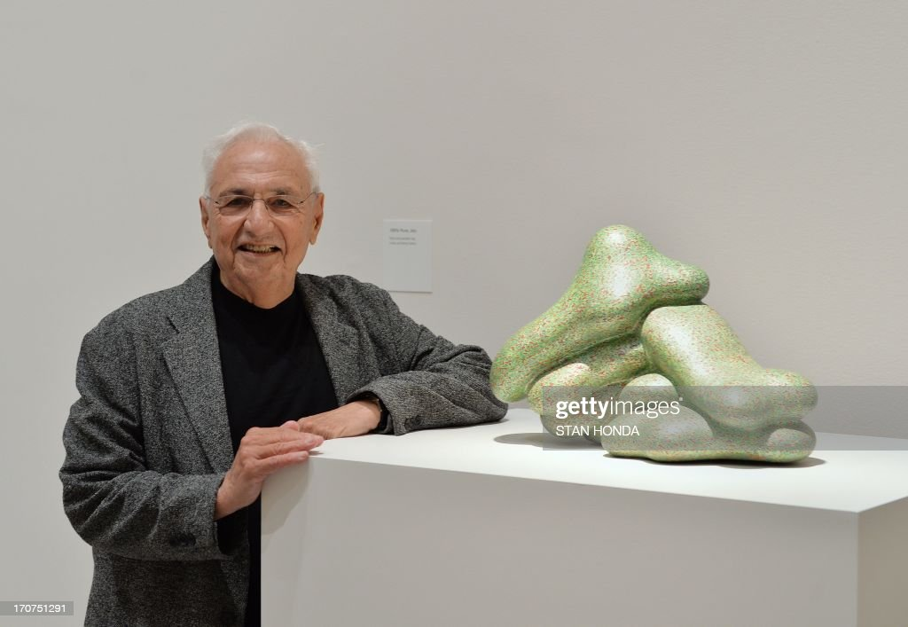 Architect Frank O. Gehry poses with '100% Pure, 2005' by sculptor Ken Price during a preview of 'Ken Price Sculpture: A Retrospective' June 17, 2003 at the Metropolitan Museum of Art in New York. The installation was designed by Gehry, a long time friend of the artist. Gehry and his wife Berta Gehry own this work and are loaning it for the exhibition. AFP PHOTO/Stan HONDA