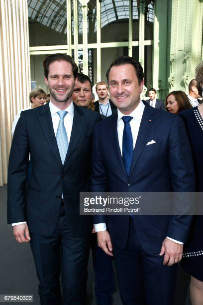 Architect Gauthier Destenay and his husband Prime Minister of Luxembourg Xavier Bettel attend the 'Revelations' Fair at Balcon d'Honneur du Grand...