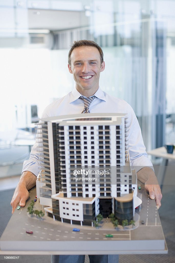 Architect holding building model : Stock Photo