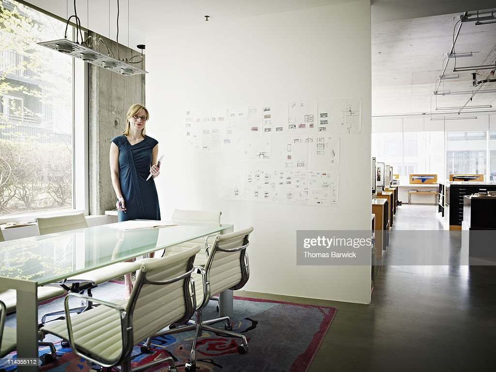 Architect holding digital tablet in office : Stock Photo