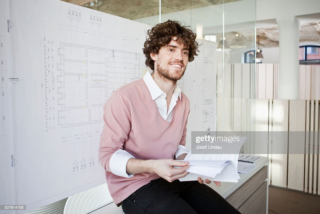Architect in office with building plans