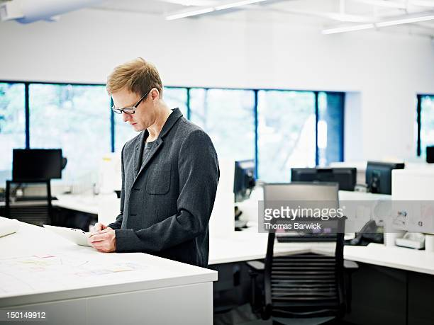 Architect in office working on digital tablet