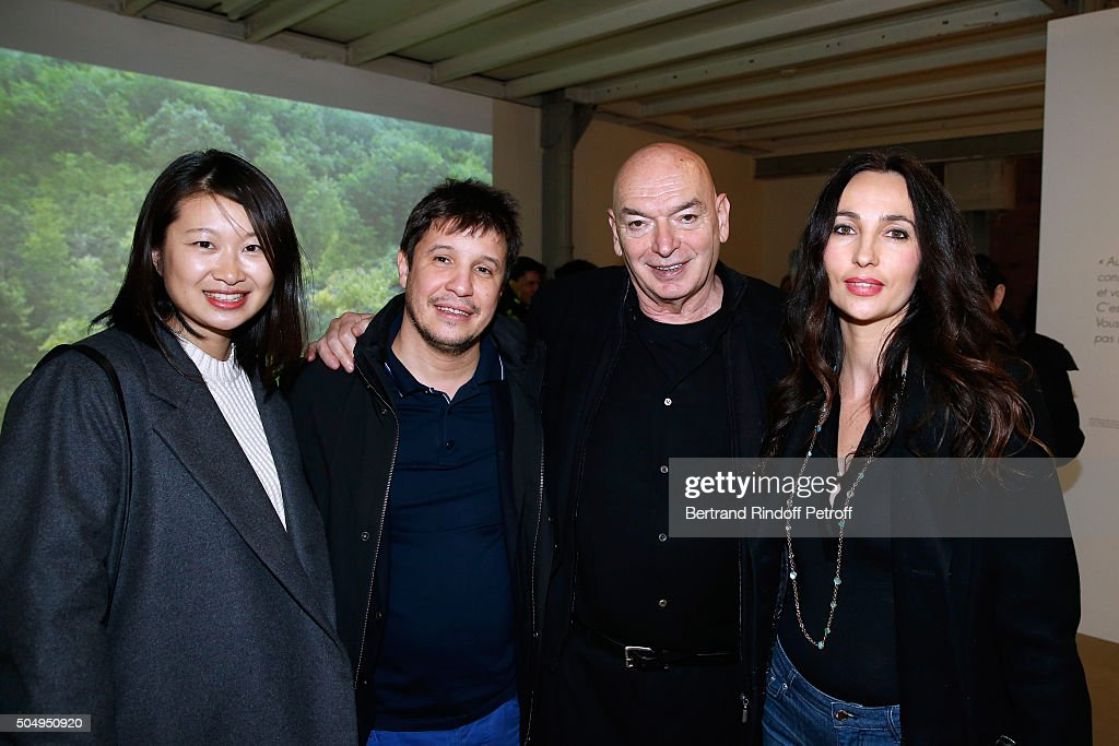 Architect <a gi-track='captionPersonalityLinkClicked' href=/galleries/search?phrase=Jean+Nouvel&family=editorial&specificpeople=488235 ng-click='$event.stopPropagation()'>Jean Nouvel</a> (2nd R) wieth his wife Lida Guan (L) and Contemporary artist <a gi-track='captionPersonalityLinkClicked' href=/galleries/search?phrase=Adel+Abdessemed&family=editorial&specificpeople=7277284 ng-click='$event.stopPropagation()'>Adel Abdessemed</a> (2nd L) with his wife Julie (R) attend the '<a gi-track='captionPersonalityLinkClicked' href=/galleries/search?phrase=Jean+Nouvel&family=editorial&specificpeople=488235 ng-click='$event.stopPropagation()'>Jean Nouvel</a> and Claude Parent, Musees a venir' Exhibition Opening at Galerie Azzedine Alaïa on January 13, 2016 in Paris, France.