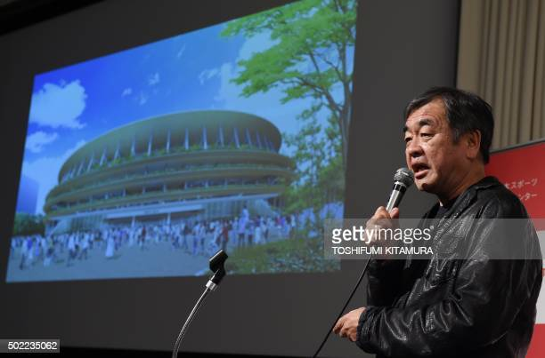 Architect Kengo Kuma explains his design of the stadium during a press conference announcing new design of the national stadium in Tokyo on December...