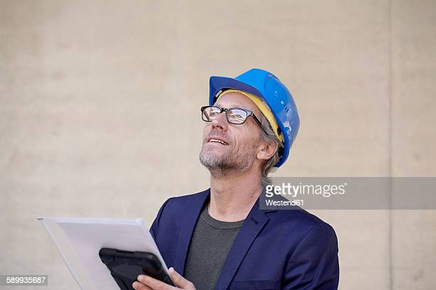 Architect on construction site looking up