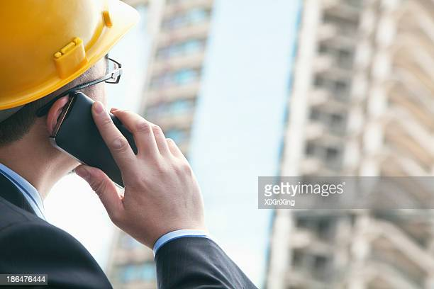 Architect on the phone at a construction site