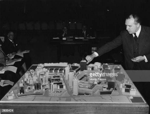 Architect Peter Chamberlain points out an area of interest on a model of the proposed scheme for rebuilding Barbican an area of north London which...