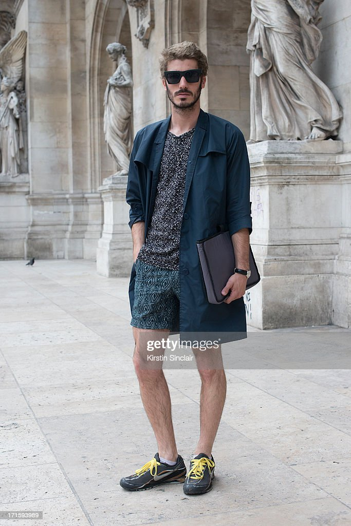 Architect Pol Valls wears Nike Trainers, H and M shorts and shirt, vintage jacket and a Kipling bag on day 1 of Paris Collections: Men on June 26, 2013 in Paris, France.