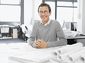 Architect posing with blueprints