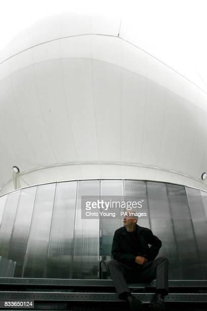 Architect Rem Koolhaas sits in front of the new inflatable canopy at the Serpentine Gallery Hyde Park London