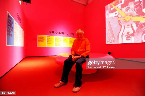 Architect Richard Rogers sits on a pink stool in a totally pink room bathed in pink lights as part of the Richard Rogers RA Inside Out exhibition at...