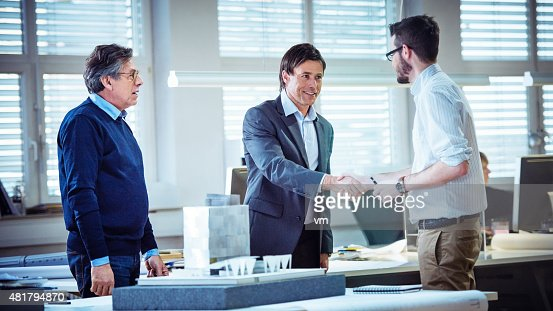 Architect shaking hand with client