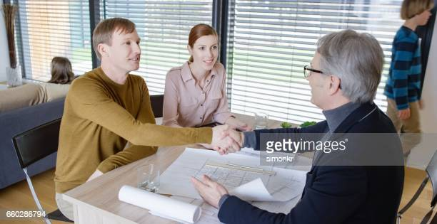 Architect shaking hand with men