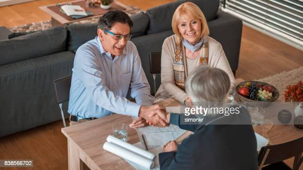 Architect shaking hands with man