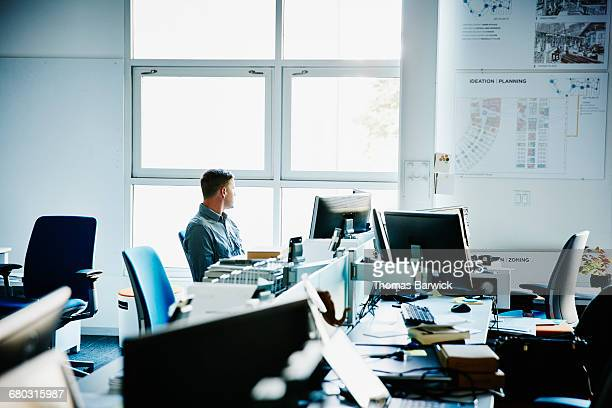 Architect sitting at office workstation