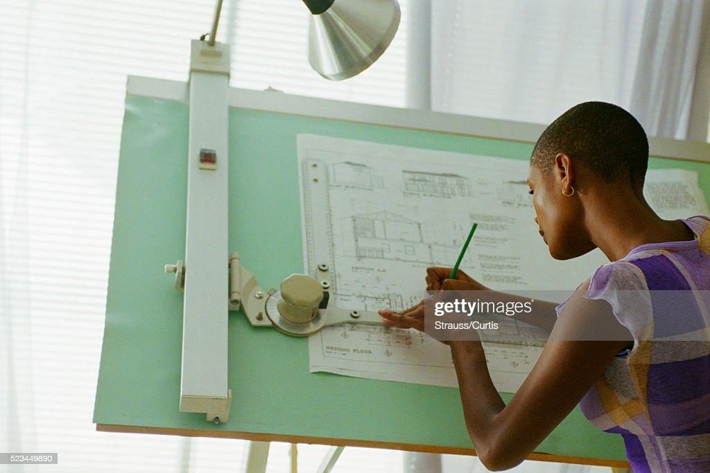 Architect Sketching At Drafting Table : Stock Photo