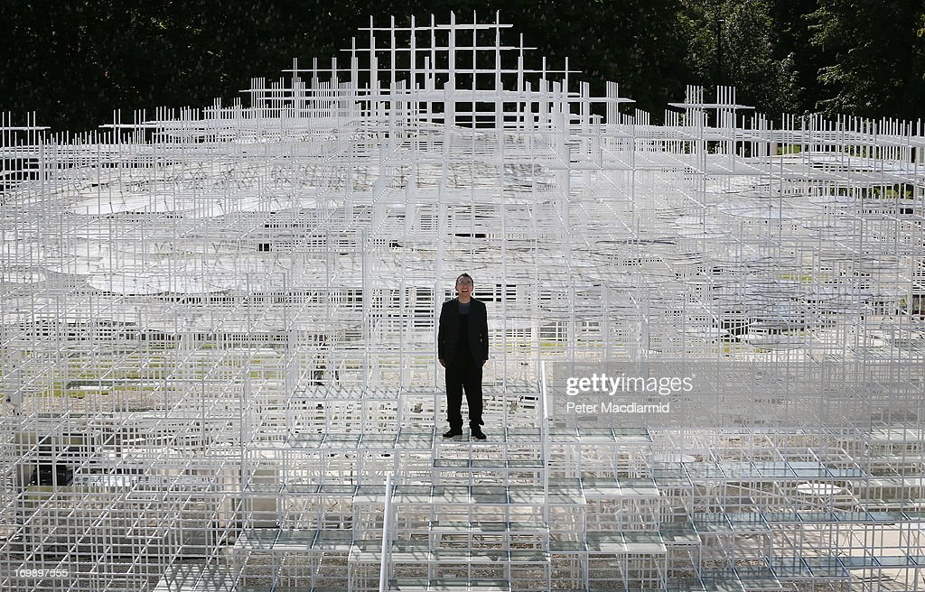 Architect Sou Fujimoto poses for photographs at his Serpentine Gallery Pavilion on June 4, 2013 in London, England. Designed by Japanese architect Sou Fujimoto, it occupies 357 square-metres of the lawn in front of the gallery. Using a latticed structure of 20 mm steel poles with a cafe sited inside, visitors are encouraged to enter and interact with the Pavilion in different ways throughout it's month tenure in London's Kensington Gardens.