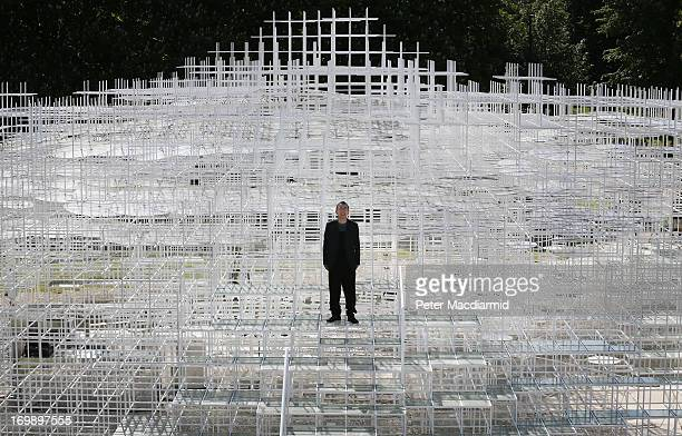 Architect Sou Fujimoto poses for photographs at his Serpentine Gallery Pavilion on June 4 2013 in London England Designed by Japanese architect Sou...