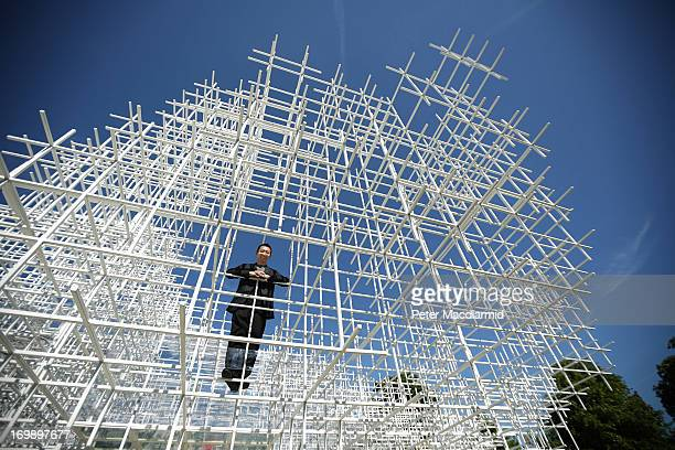 Architect Sou Fujimoto stands inside his Serpentine Gallery Pavilion on June 4 2013 in London England Designed by Japanese architect Sou Fujimoto it...