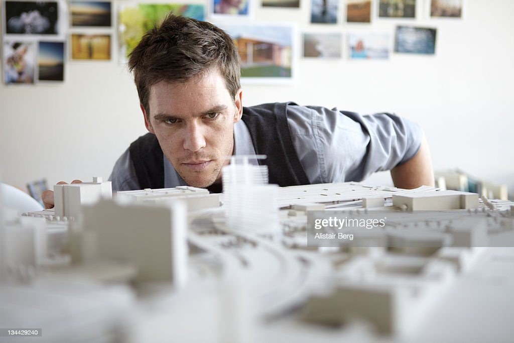 Architect studying model