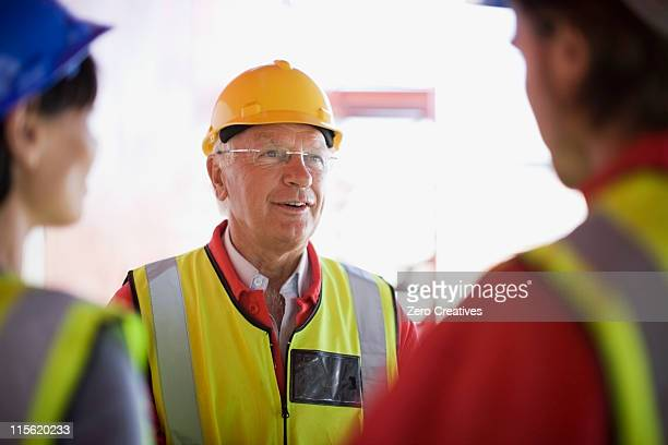 Architect talking to some builders