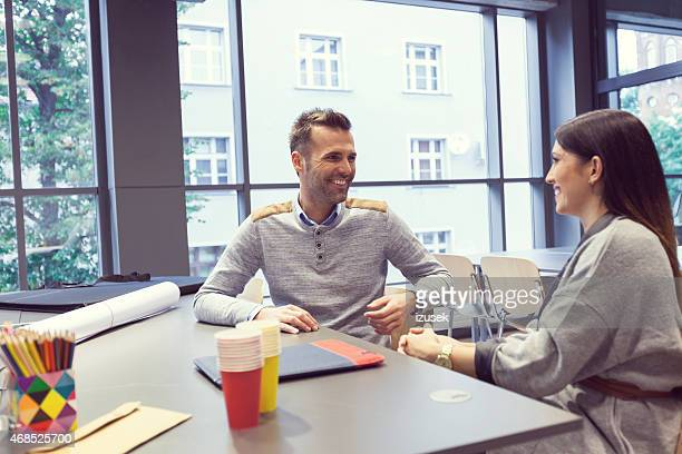 Architect talking with his client in an office