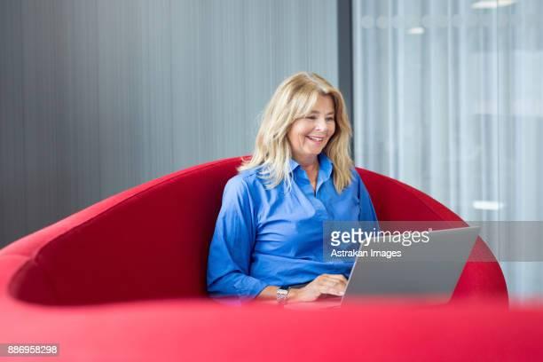 Architect using laptop on sofa