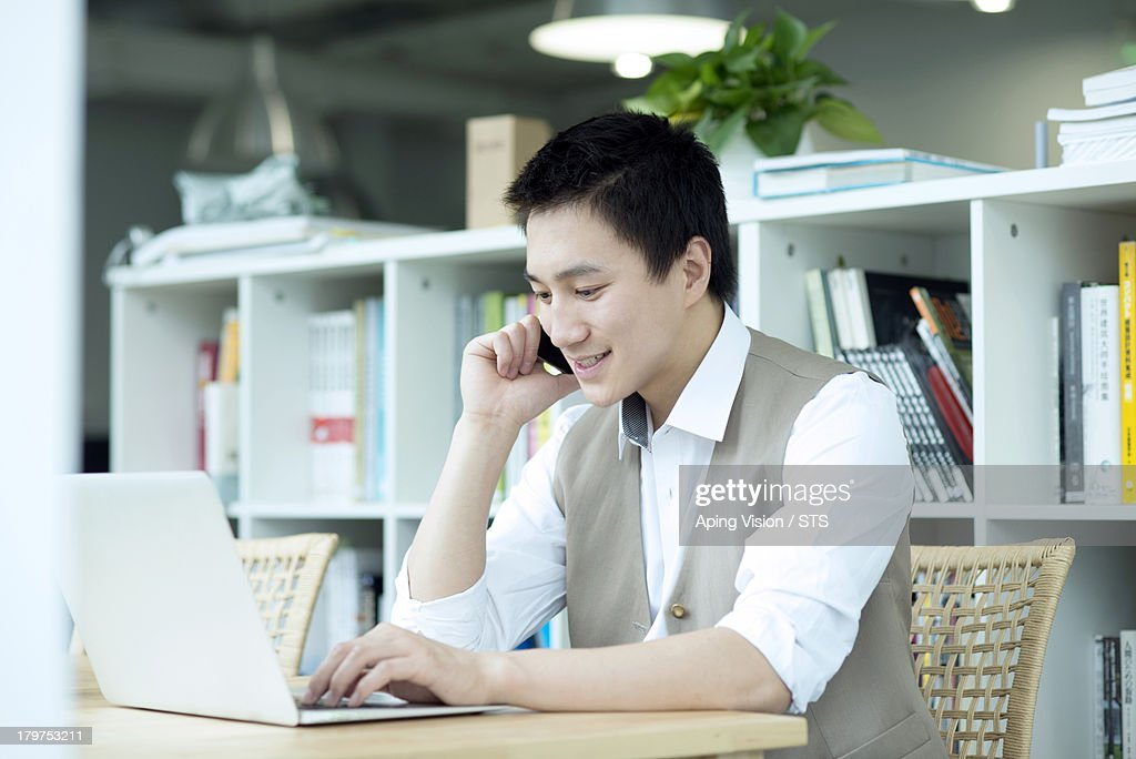 architect using mobile phone in the office : Stock Photo