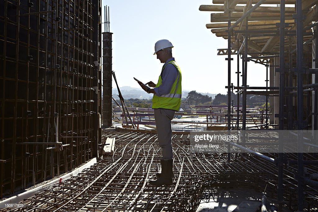 Architect using tablet computer : Stock Photo