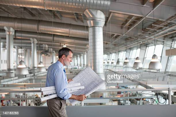 Architect viewing blueprints