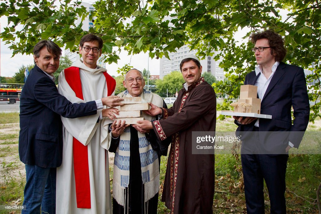 Architect Wilfried Kuehn (R) holds the model of 'House of One' in his hand beside actor Wolfgang Bahro (L), Father Gregor Hohberg (2nd.L) Rabbi Tovia Ben-Chorin (C), and Imam Kadir Sanci (2nd.R) holding symbolic bricks in their hands as they standing at the construction site of the future 'House of One' at Petriplatz on June 3, 2014 in Berlin, Germany. The initiative aims to bring together Jews, Christians and Muslims in one building that will house a synagogue, a church and a mosque, with a common area for exchange and discussion.