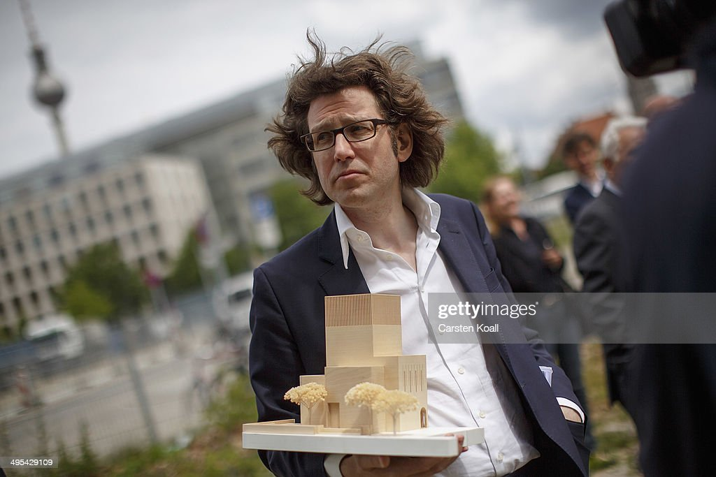 Architect Wilfried Kuehn holds the model of 'House of One' in his hands while standing at the construction site of the future 'House of One' at Petriplatz on June 3, 2014 in Berlin, Germany. The initiative aims to bring together Jews, Christians and Muslims in one building that will house a synagogue, a church and a mosque, with a common area for exchange and discussion.