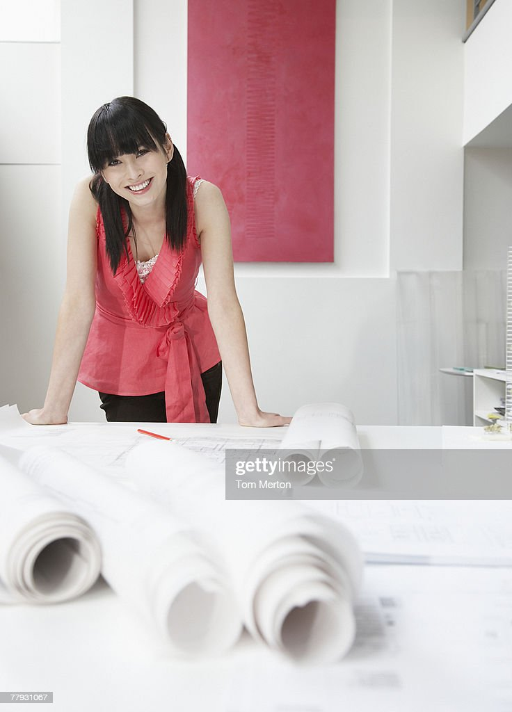 Architect with drafts in office : Stock Photo