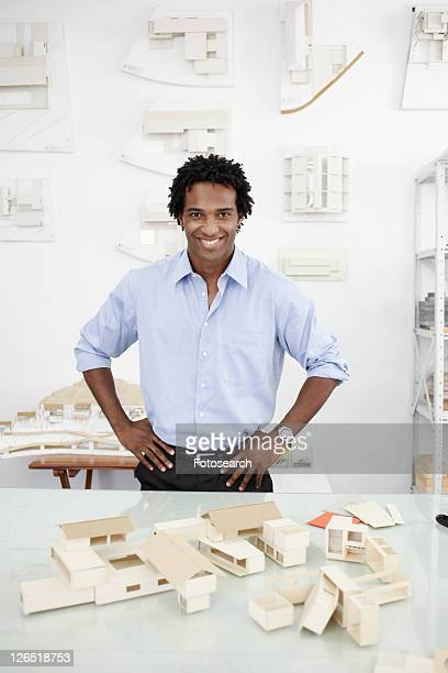 Architect with models of houses (portrait)