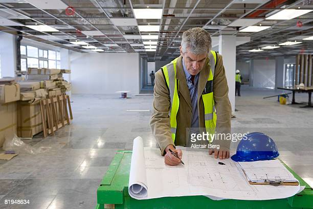 Architect working inside unfinished office development